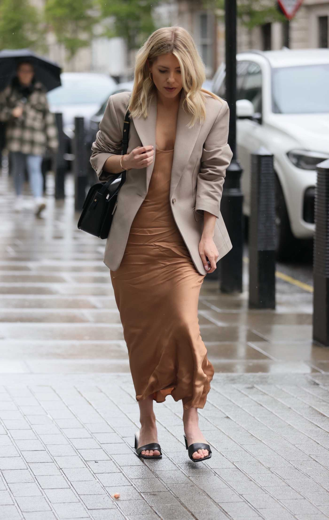 Mollie King in a Beige Blazer Arrives at the BBC Radio 1 in London 05/16/2021