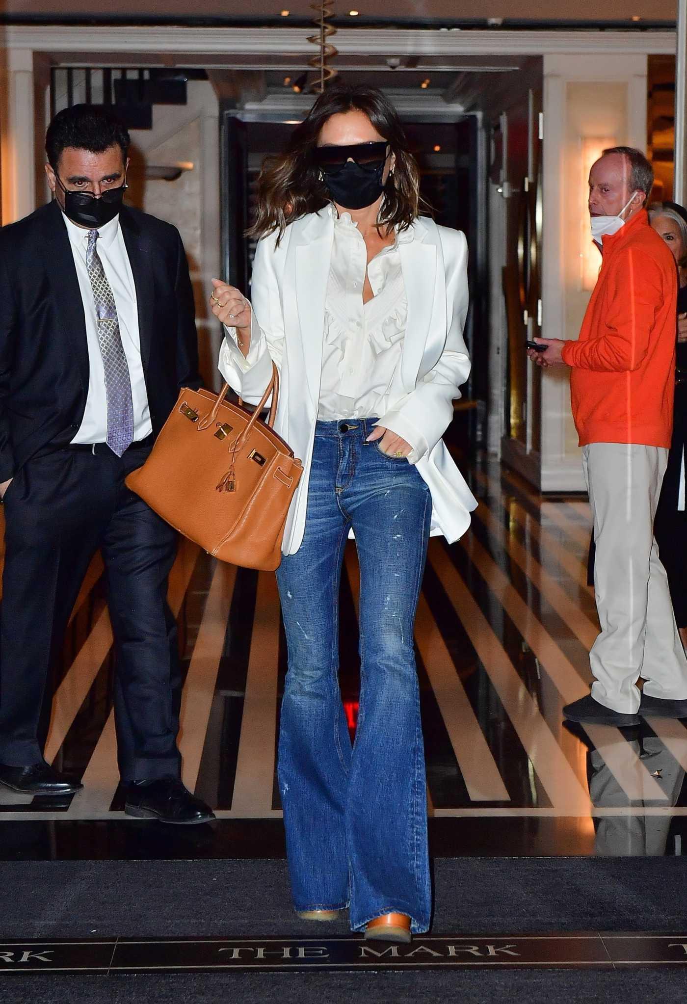Victoria Beckham in a White Blazer Leaves The Mark Hotel in New York 05/24/2021