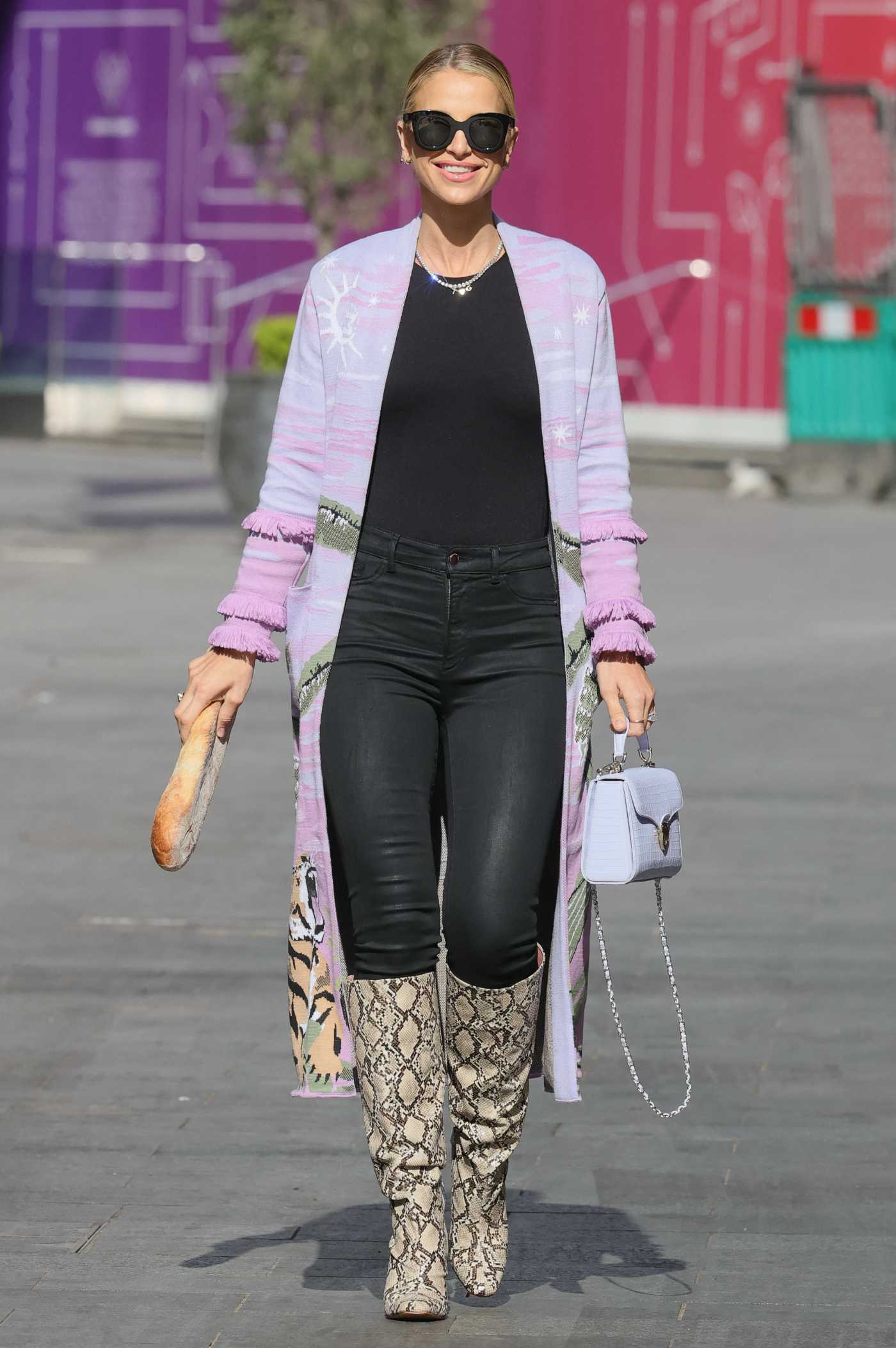 Vogue Williams in a Lilac Cardigan Steps Out for Her Weekly Radio Appearance in London 05/09/2021