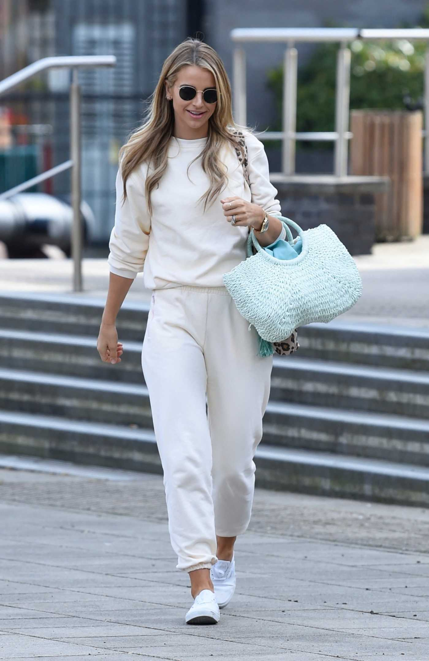 Vogue Williams in a White Sweatsuit Arrives at Stephs Packed Lunch TV Show in Leeds 05/13/2021