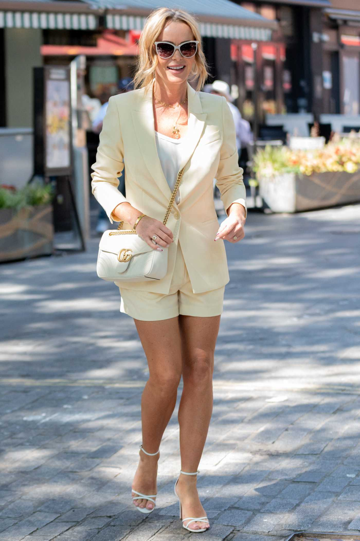 Amanda Holden in a White Blazer Leaves the Global Studios in London 06/14/2021