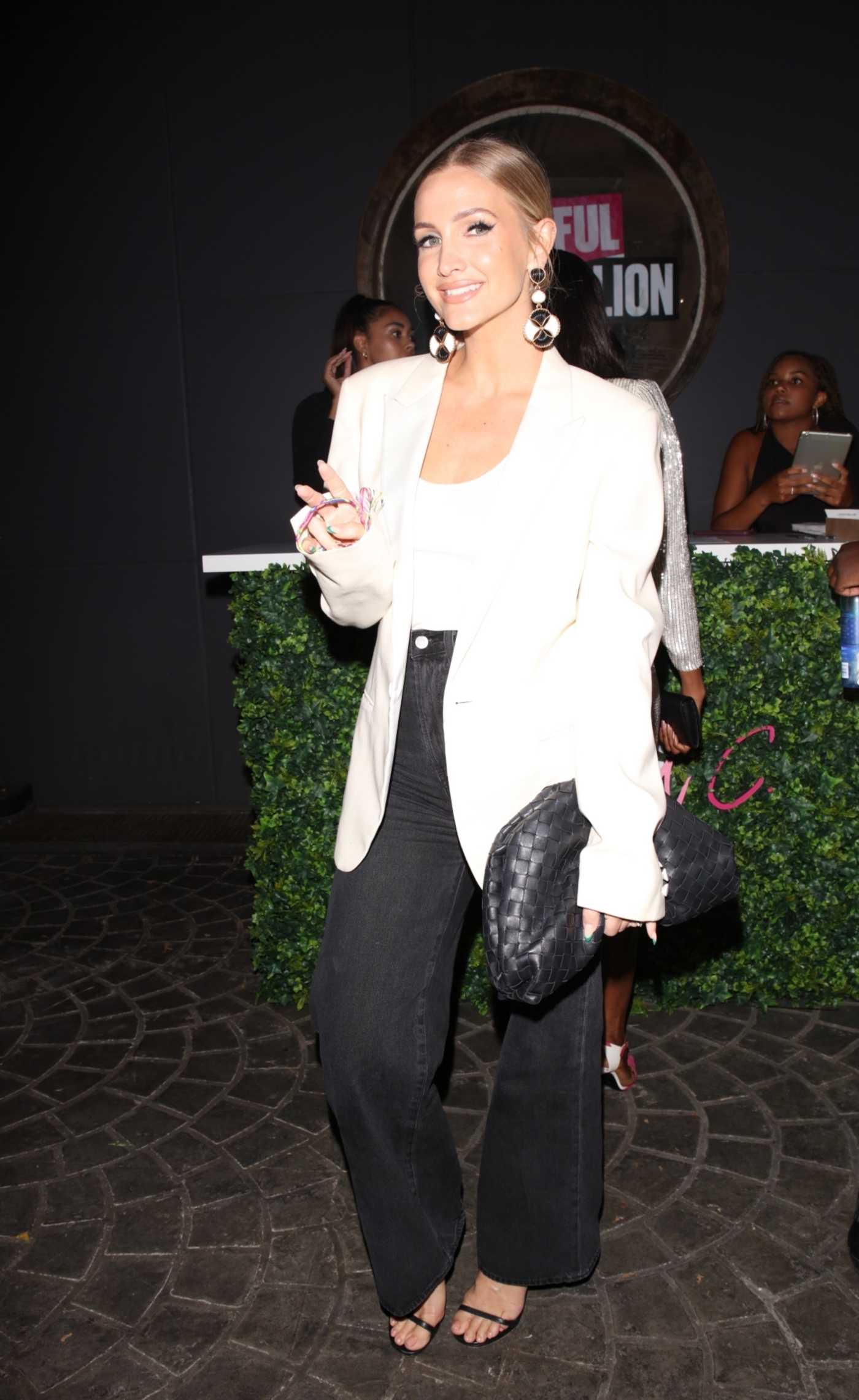 Ashlee Simpson in a White Blazer Arrives at the UOMA Beauty by Sharon C. Event in Hollywood 06/18/2021