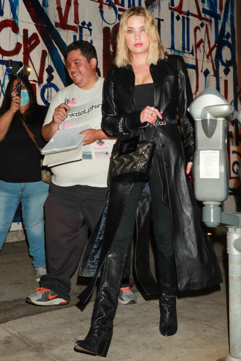 Ashley Benson in a Black Leather Trench Coat