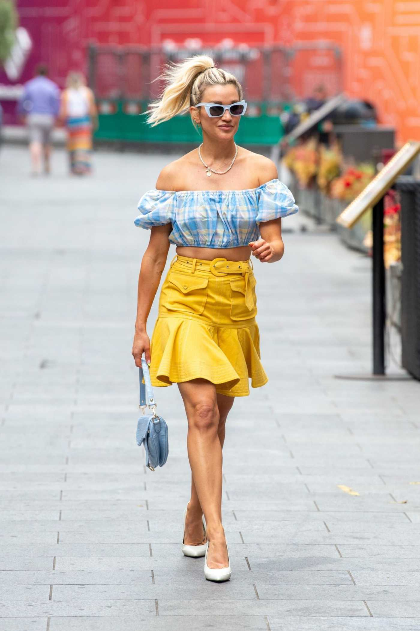 Ashley Roberts in a Yellow Skirt Arrives at the Heart Radio in London 06/11/2021