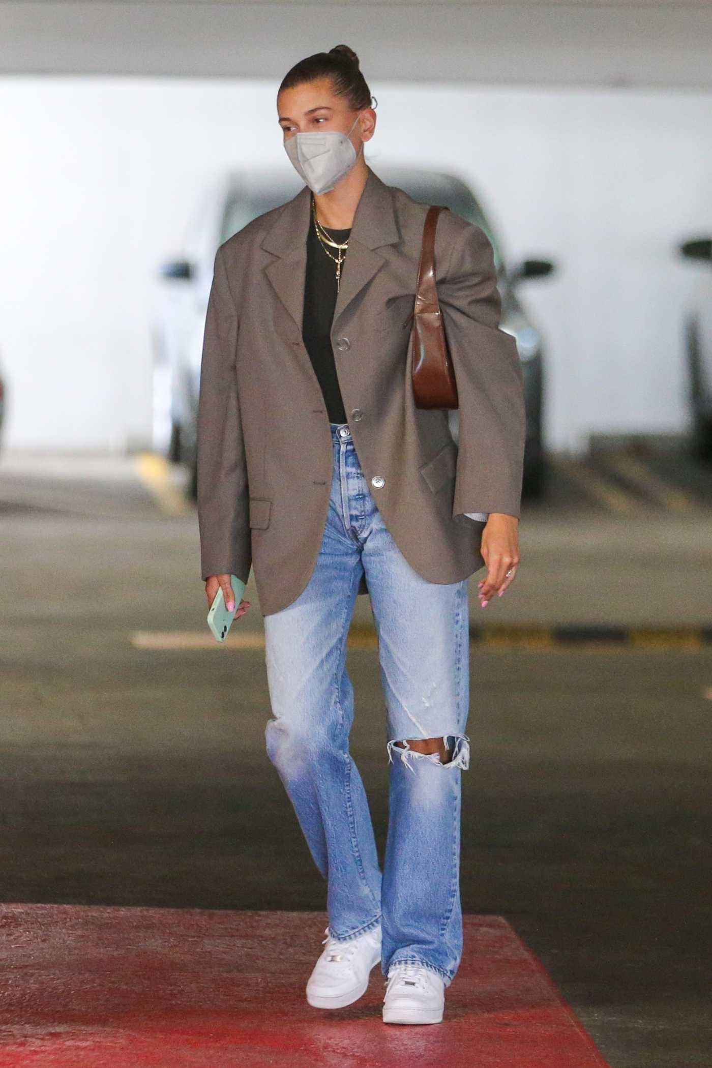 Hailey Baldwin in a Blue Ripped Jeans Arrives at a Business Building Ahead of a Meeting in Beverly Hills 06/16/2021