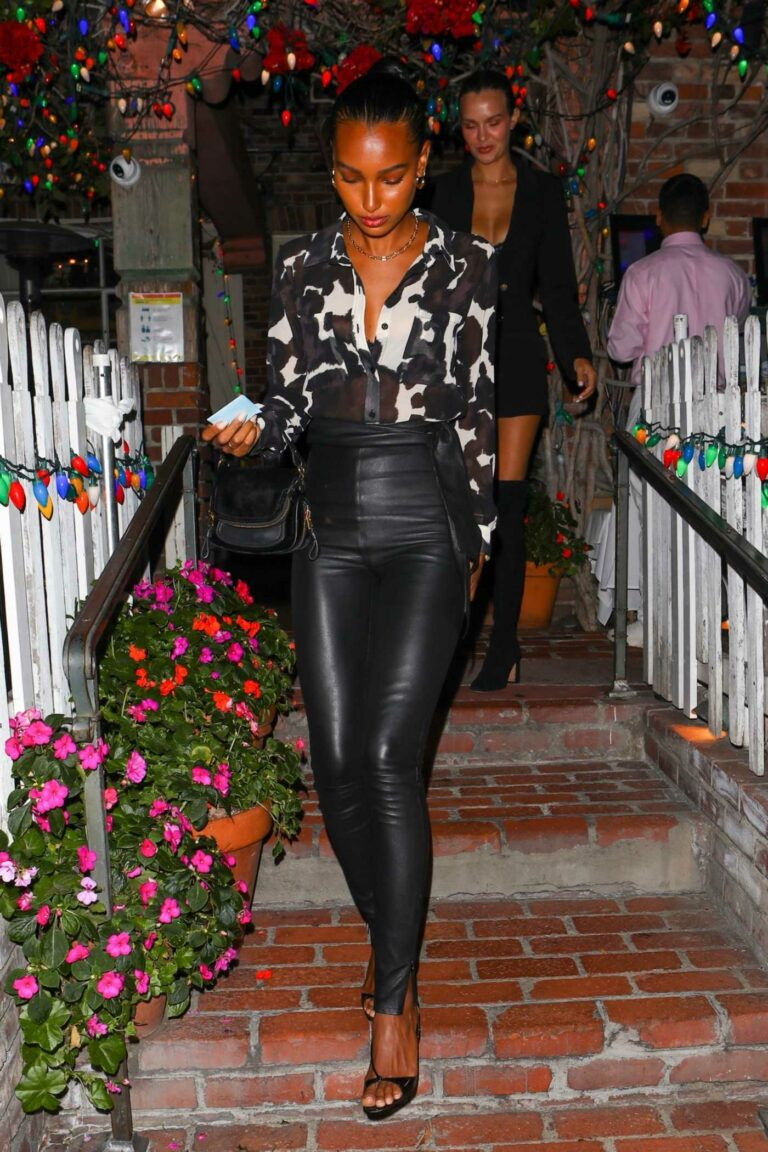 Jasmine Tookes in a Black and White Animal Print Blouse