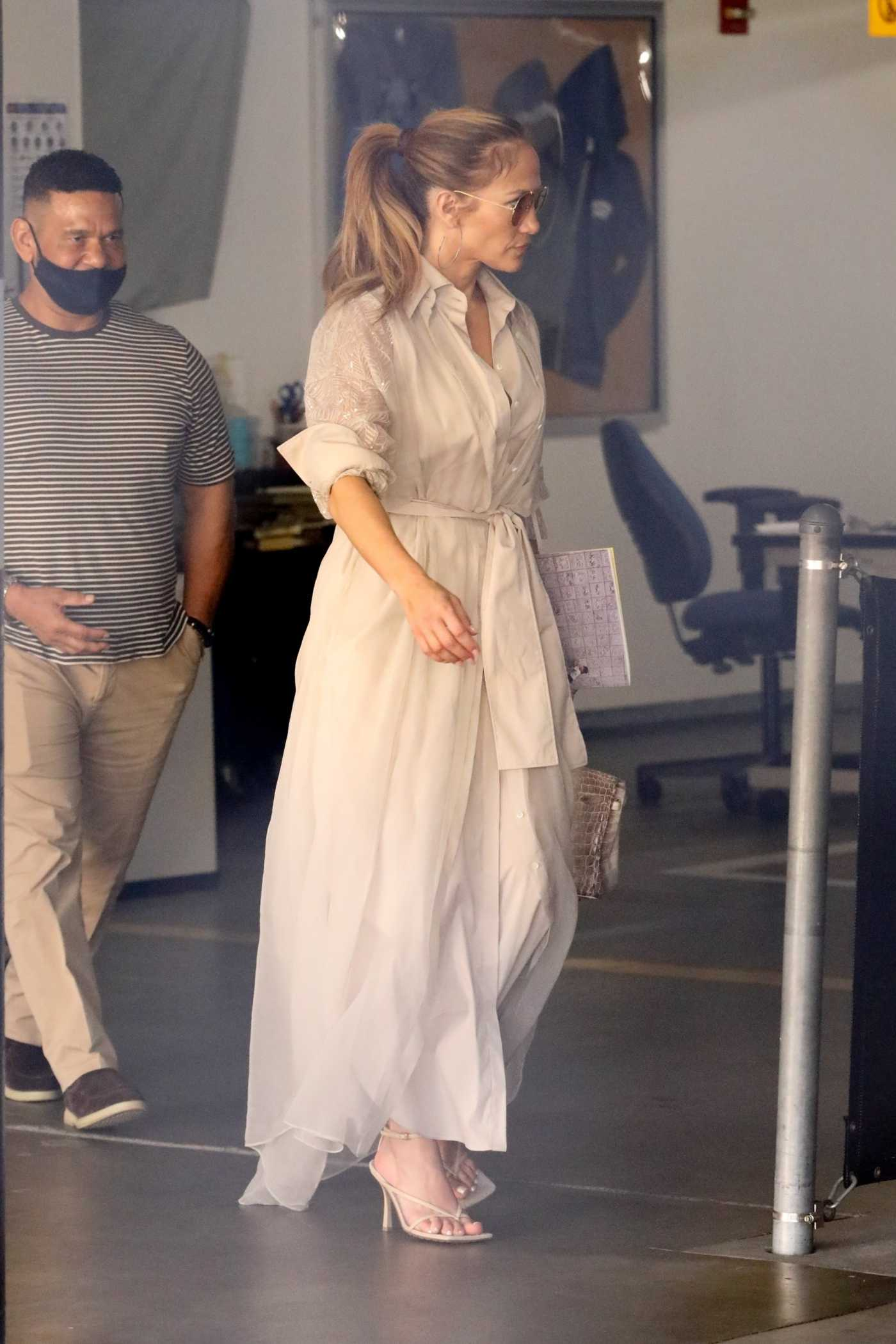 Jennifer Lopez in a Beige Dress Leaves the Wildwood Independent School in Los Angeles 06/04/2021