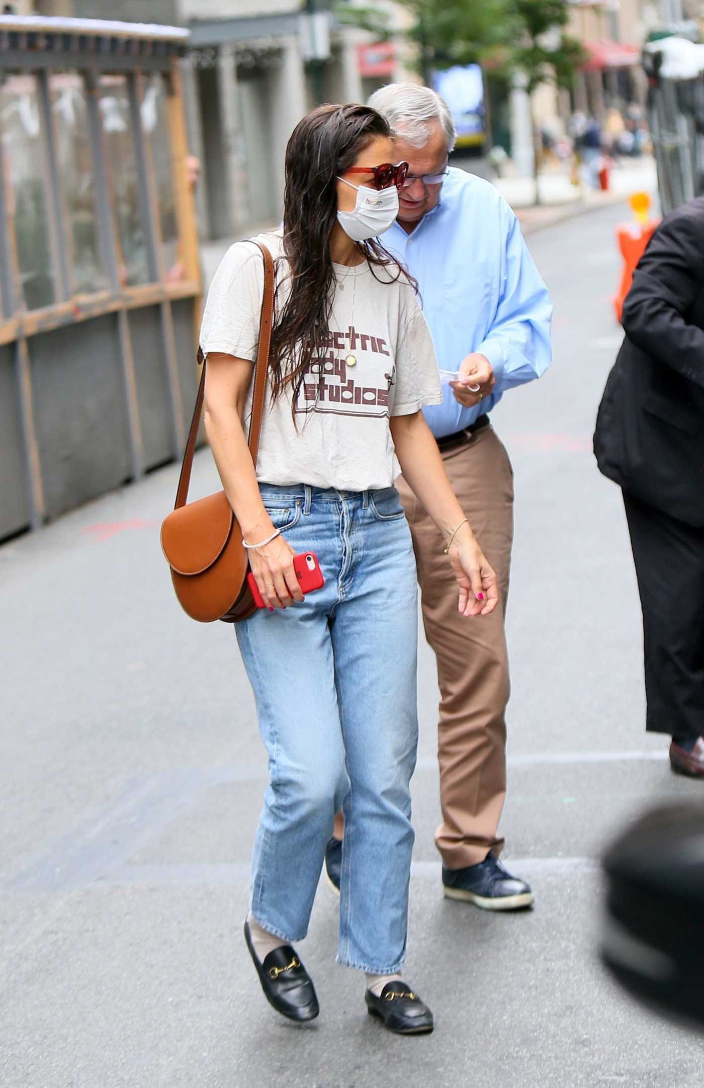 Katie Holmes in a White Tee Was Seen Out with Her Parents in New York 06/12/2021