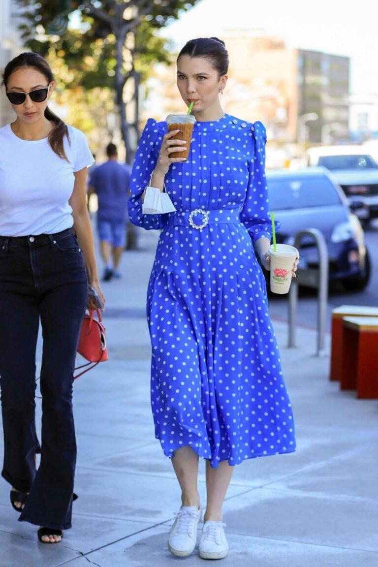 Maya Henry in a Blue Polka Dot Dress