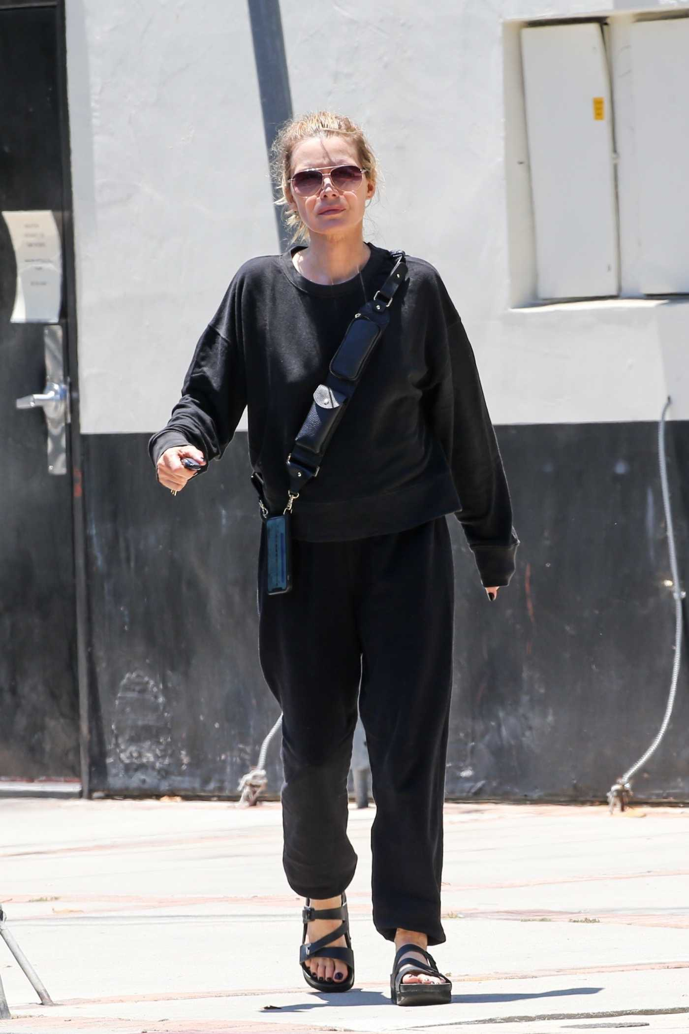 Michelle Pfeiffer in a Black Sweatsuit Was Seen Out in Brentwood 06/14/2021