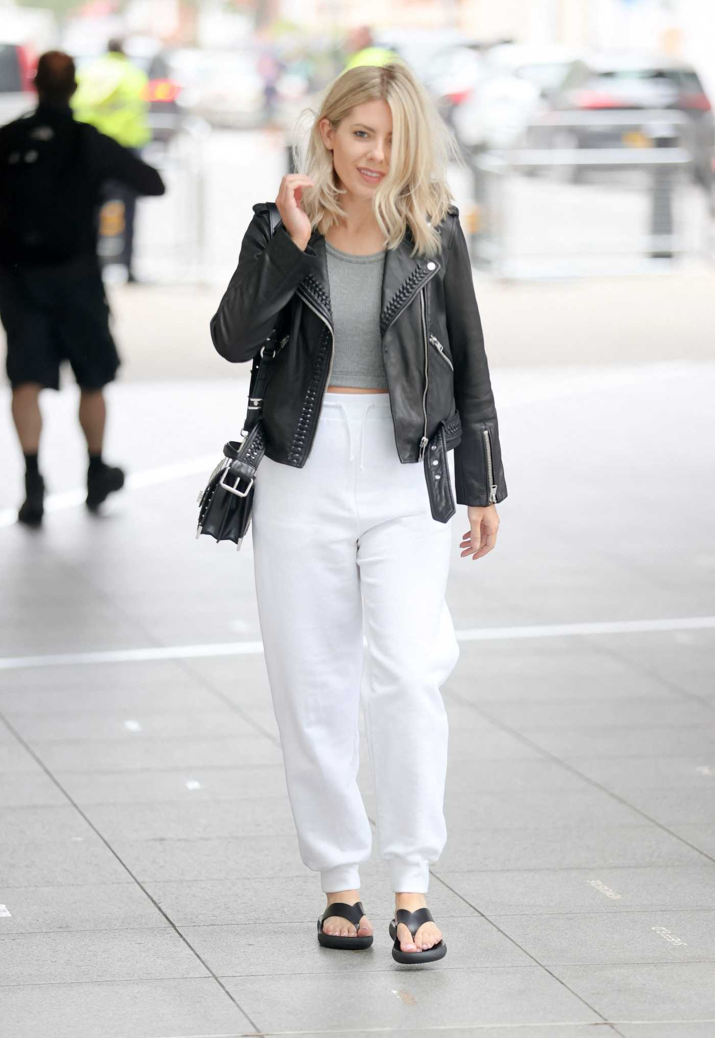 Mollie King in a White Pants Arrives at the BBC Studios in London 06/27/2021