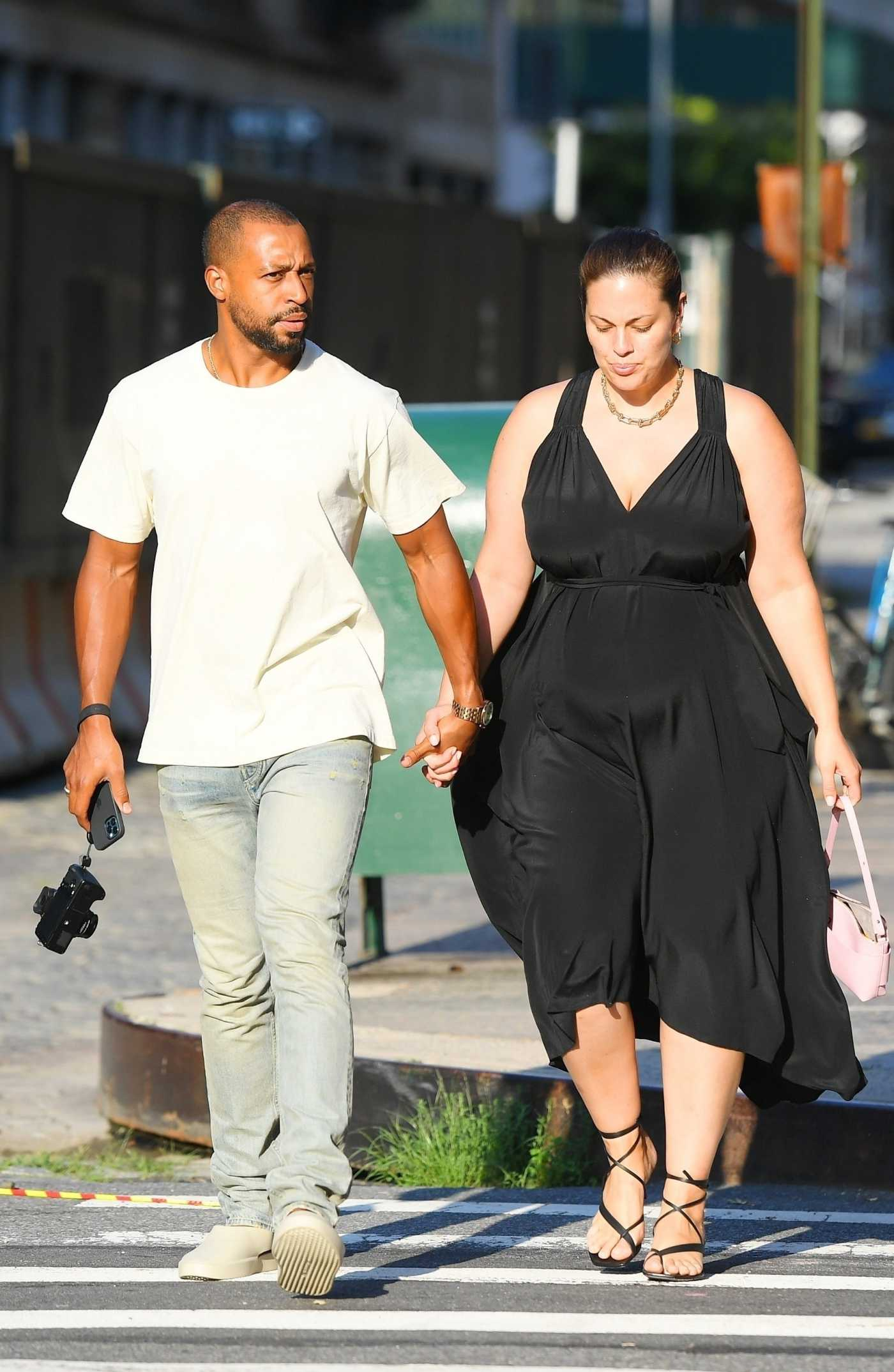 Ashley Graham in a Black Dress Was Seen Out with Her Husband Justin Ervin in Tribeca, New York 07/19/2021