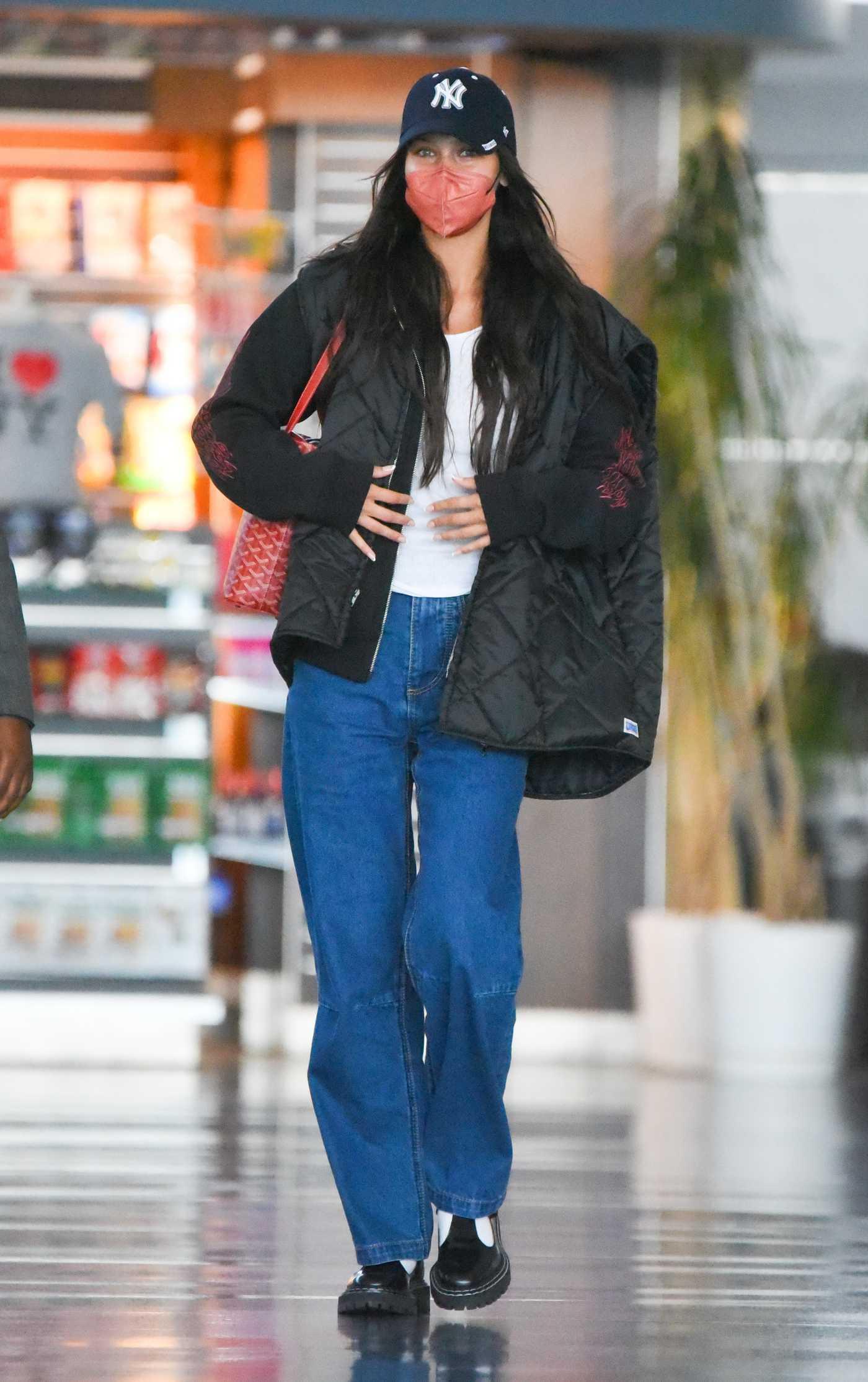 Bella Hadid in a Black Cap Arrives at JFK Airport in New York 07/16/2021