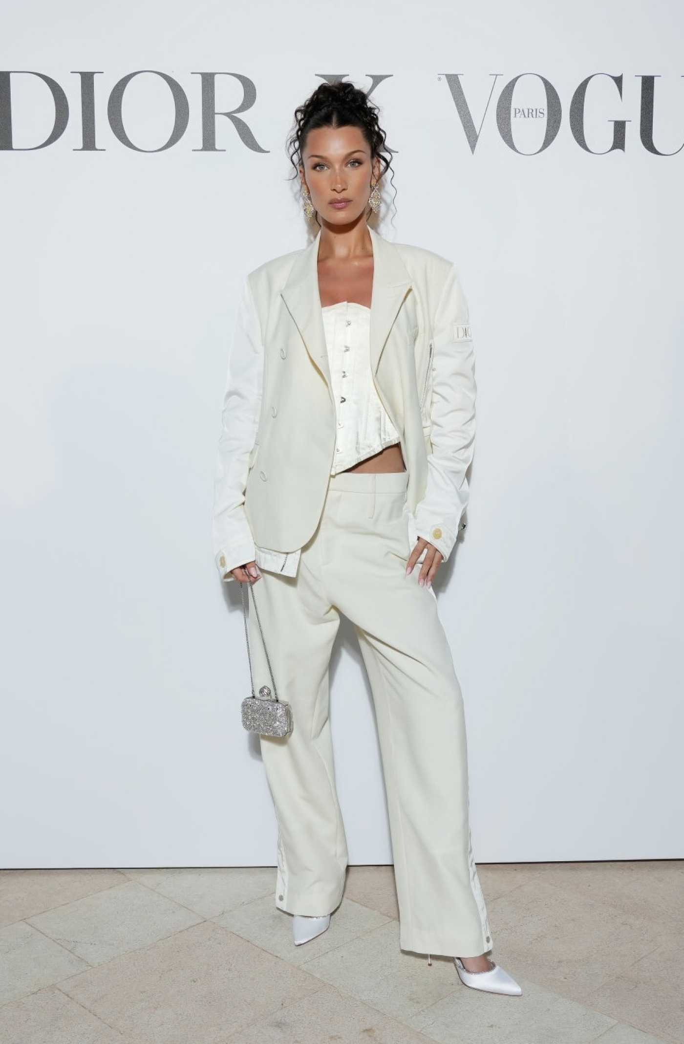 Bella Hadid in a White Suit Attends the Dior Dinner During the 74th Annual Cannes Film Festival in Cannes 07/10/2021