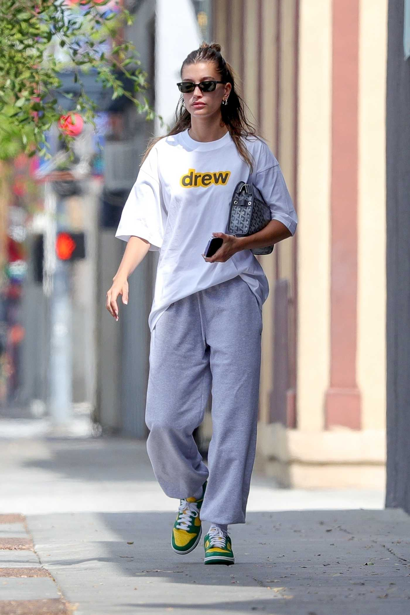 Hailey Baldwin in a White Tee Leaves the Voda Spa in West Hollywood 07/25/2021