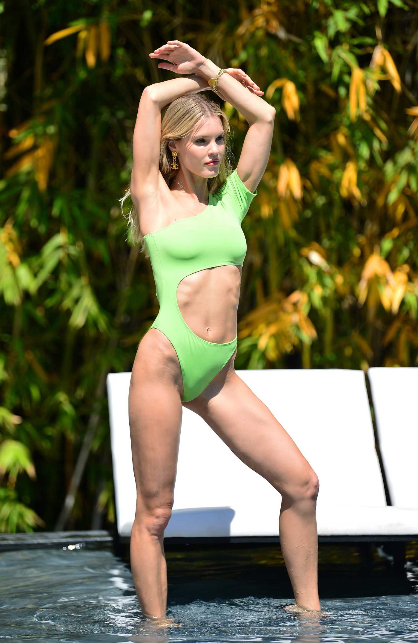 Joy Corrigan in a Neon Green Swimsuit Does a Photo Session at the Alo House in Los Angeles 06/28/2021