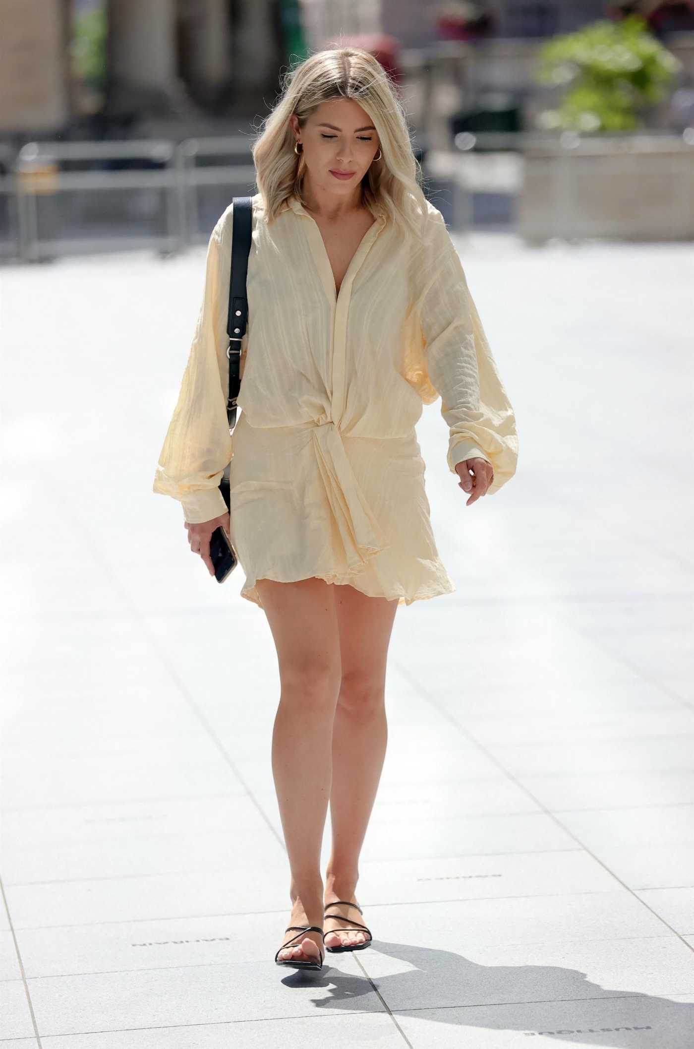 Mollie King in a Cream Mini Dress Arrives at the BBC Studios in London 07/16/2021