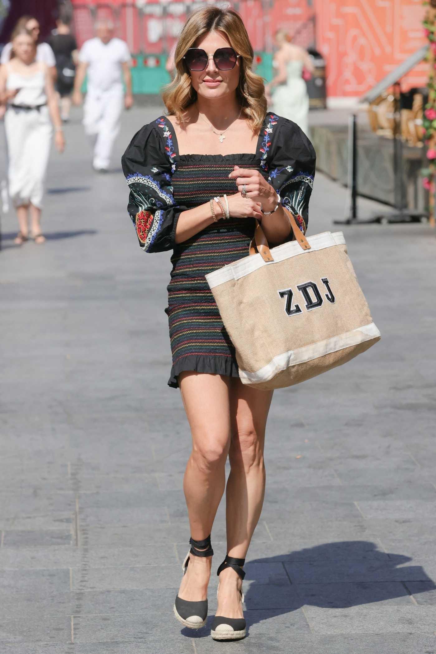 Zoe Hardman in a Black Striped Mini Dress Arrives at the Heart Radio in London 07/19/2021
