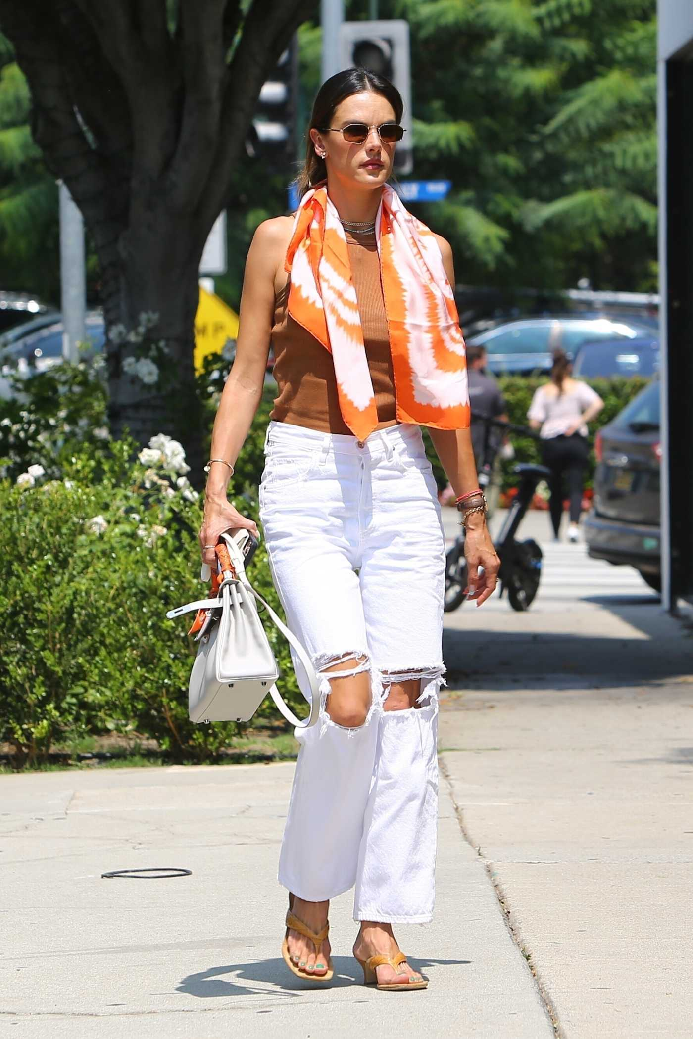 Alessandra Ambrosio in a White Ripped Jeans Arrives for a Business Meeting in Beverly Hills 08/24/2021
