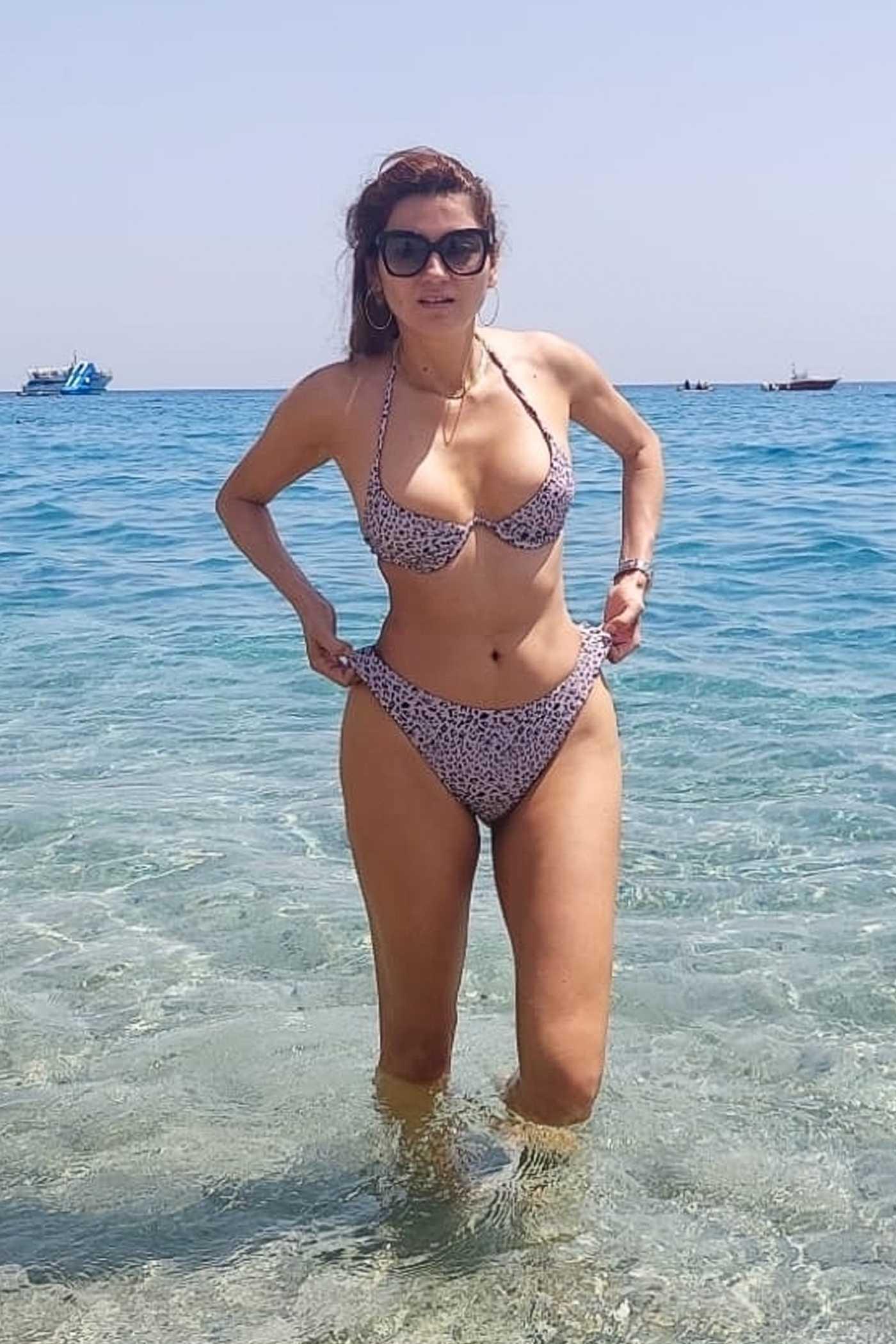 Blanca Blanco in an Animal Print Bikini on the Beach in Cantazaro, Italy 07/31/2021