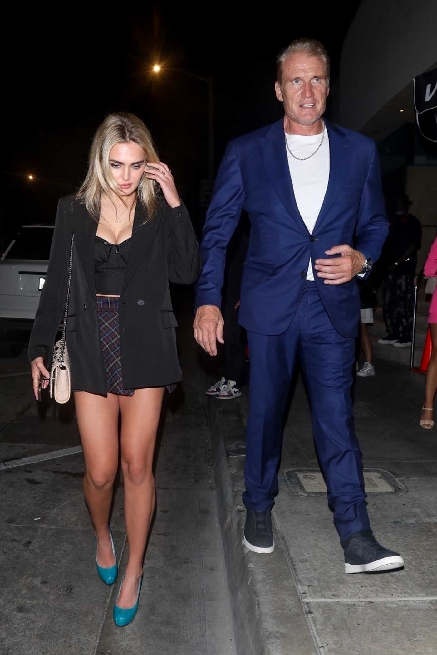 Dolph Lundgren in a Blue Suit Arrives for Dinner at Catch LA Out with Emma Krokdal in West Hollywood 07/31/2021