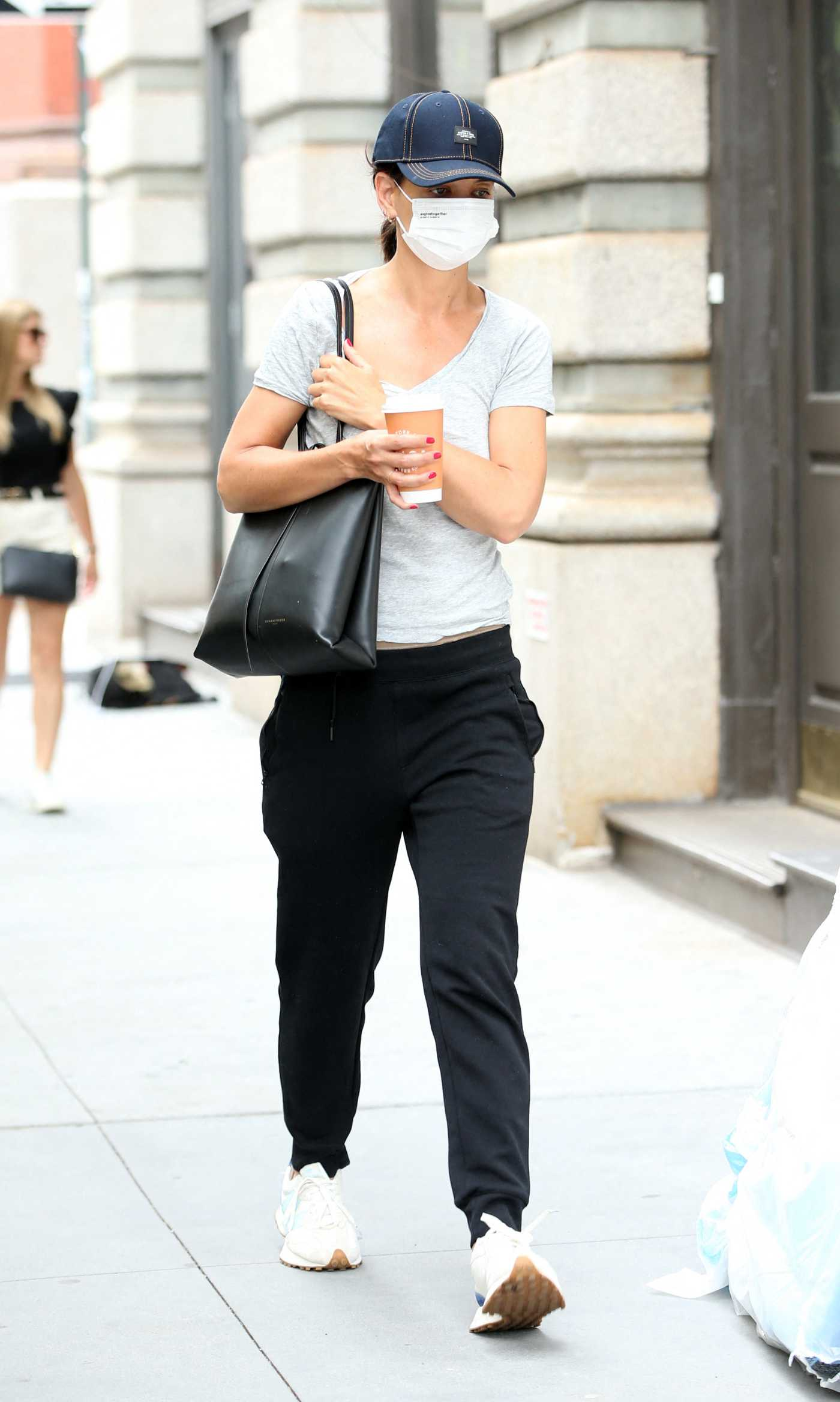 Katie Holmes in a Blue Cap Grabs Her Morning Coffee in New York 08/03/2021