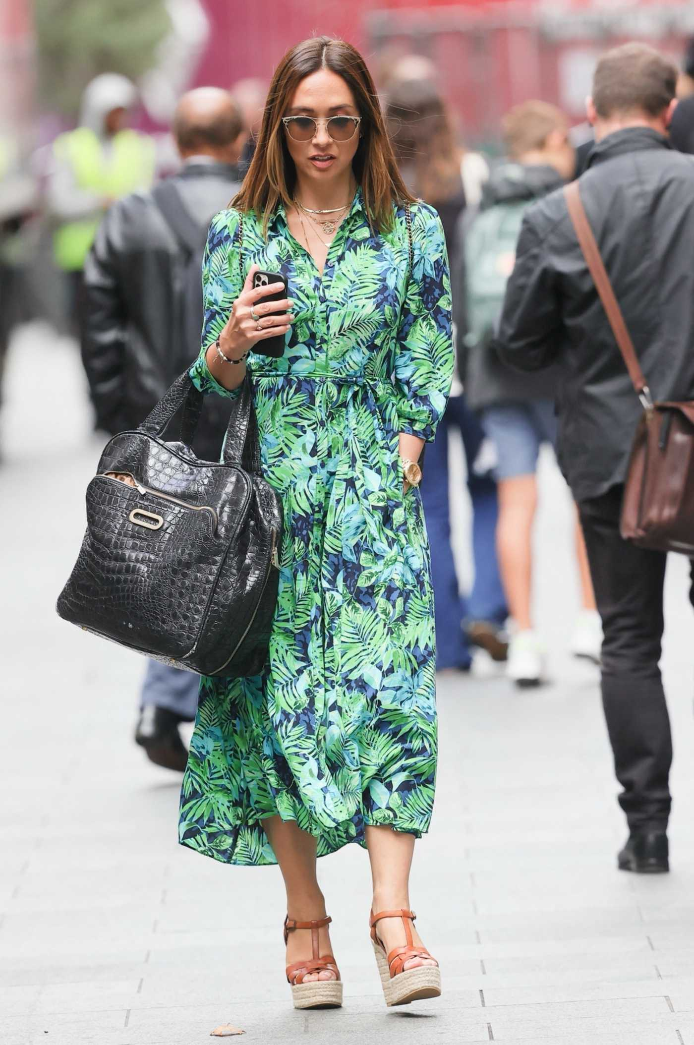 Myleene Klass in a Green Floral Dreess Arrives at the Smooth Radio in London 08/25/2021