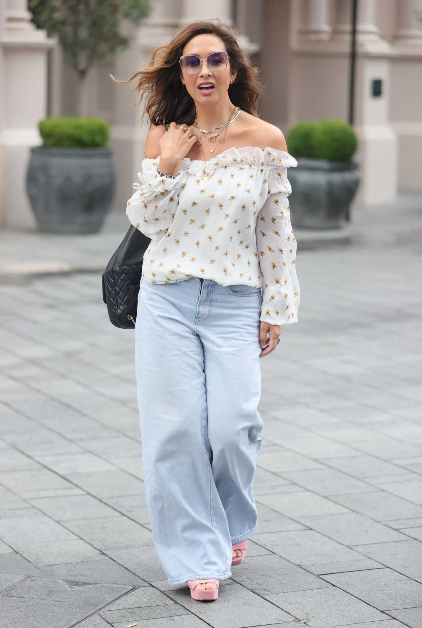 Myleene Klass in a White Floral Blouse Arrives at the Global Studios in London 08/19/2021
