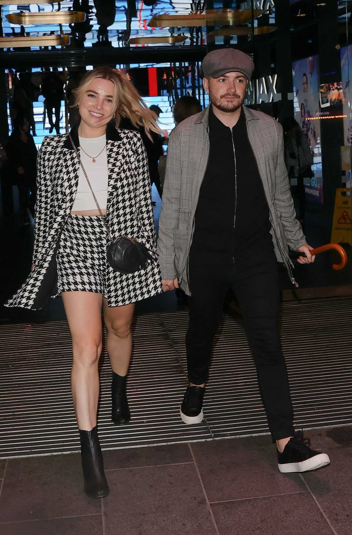 Sian Welby in a Grey Shorts Suit Holding Hands with Male Friend in London 08/09/2021