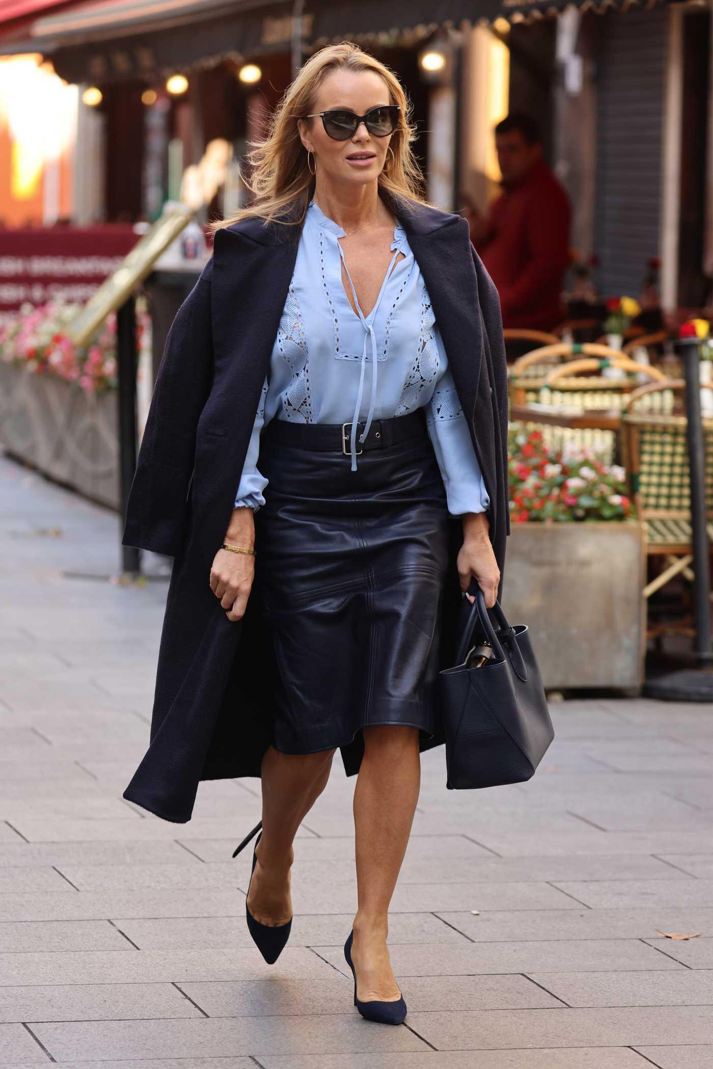 Amanda Holden in a Black Coat Leaves the Global Radio Studios in London 09/29/2021