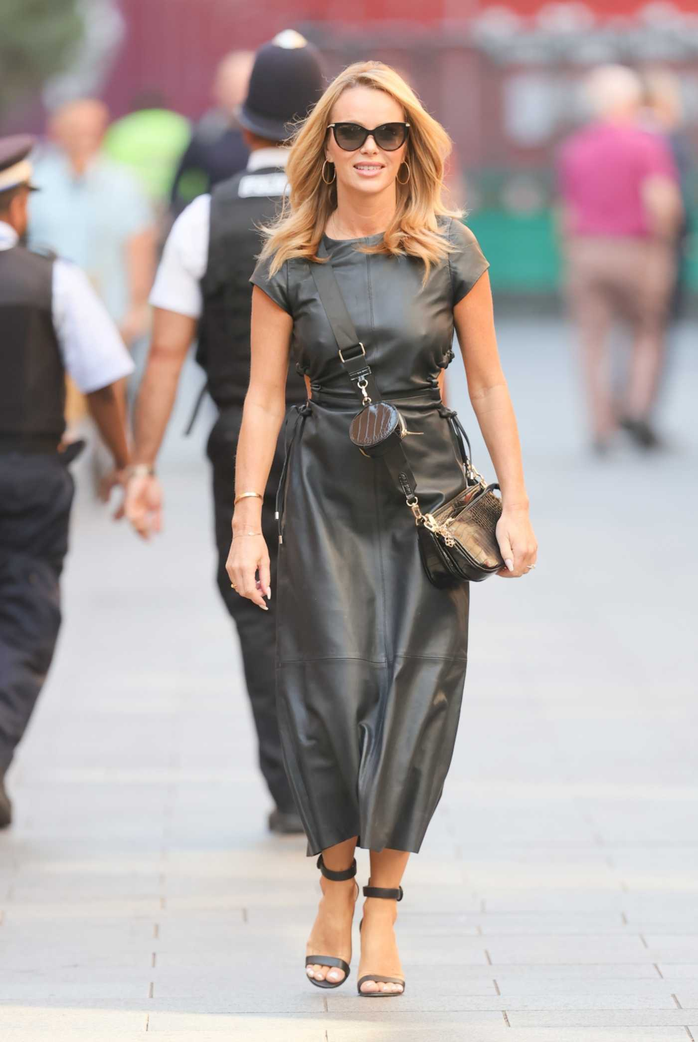 Amanda Holden in a Black Leather Dress Arrives at the Global Radio Studios in London 09/22/2021