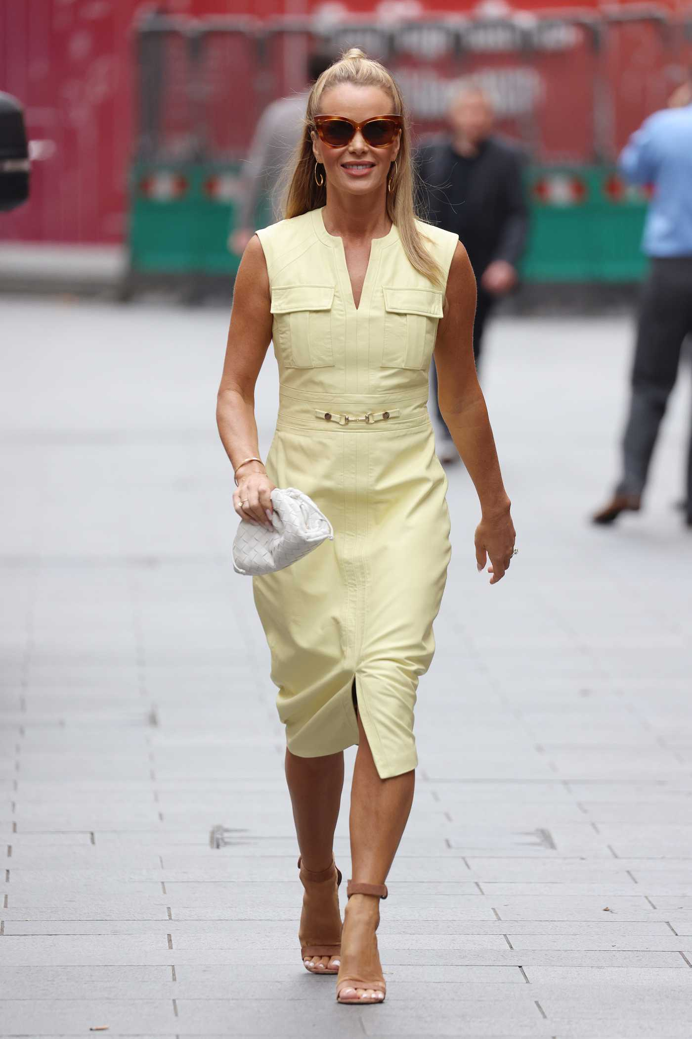 Amanda Holden in a Yellow Dress Arrives at the Global Radio Studios in London 09/15/2021