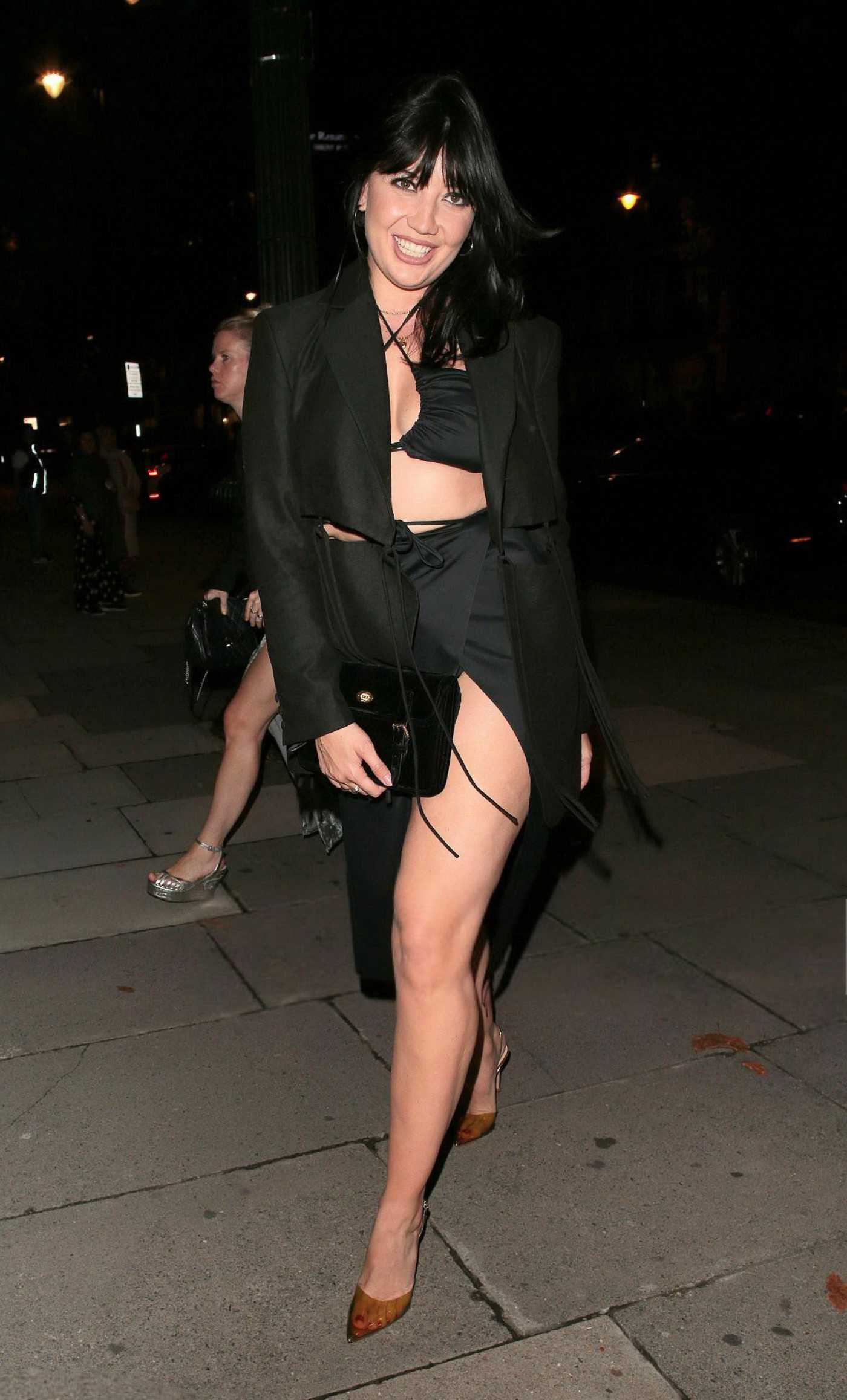 Daisy Lowe in a Black Outfit Arrives at the Richard Malone Fashion Show During London Fashion Week in London 09/19/2021