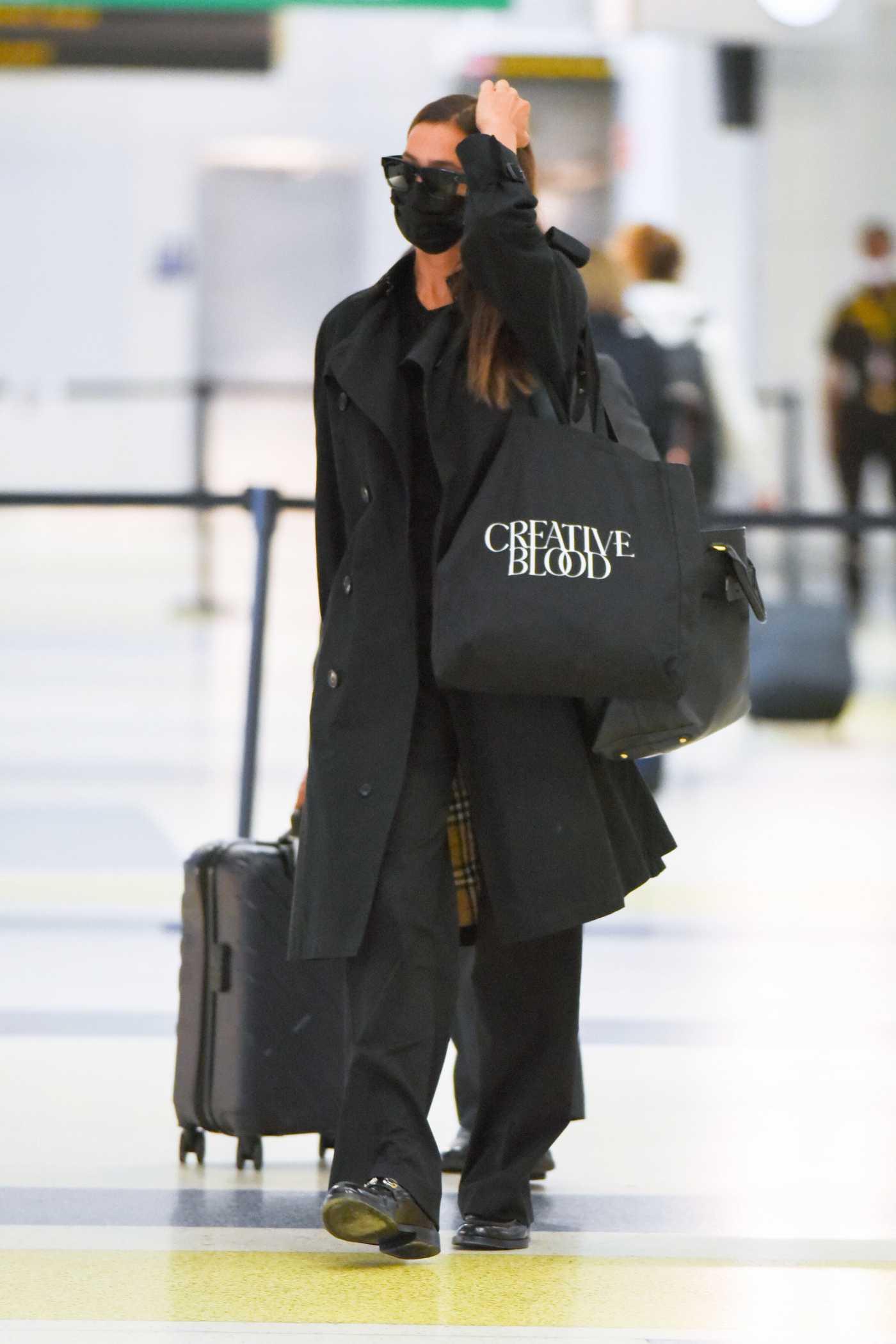 Irina Shayk in a Black Trench Coat Arrives at JFK Airport in New York 09/07/2021