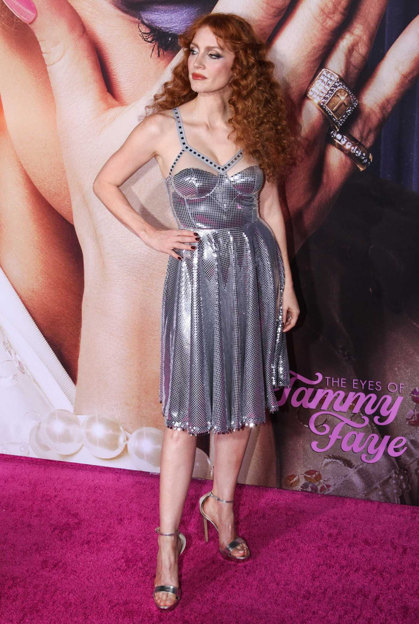 Jessica Chastain in a Silver Dress Attends The Eyes of Tammy Faye Premiere at SVA Theater in New York City 09/14/2021