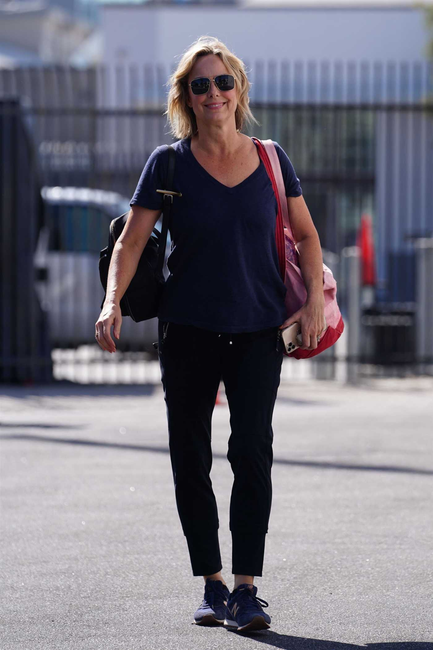 Melora Hardin in a Blue Tee Arrives at the Dancing With The Stars Rehearsal Studio in Los Angeles 09/14/2021