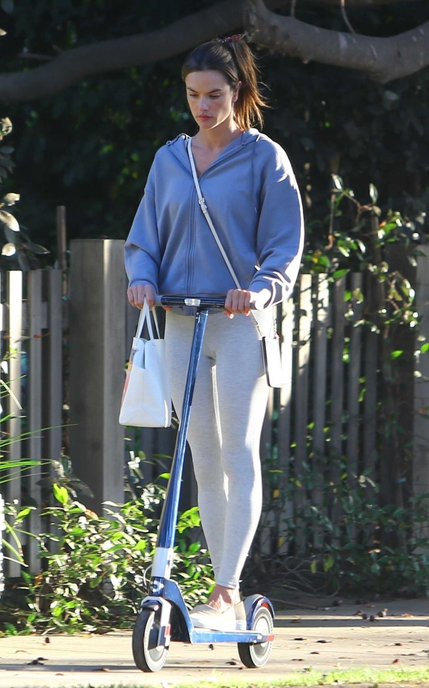 Alessandra Ambrosio in a Grey Leggings Does a Scooter Ride Out in Brentwood 10/13/2021