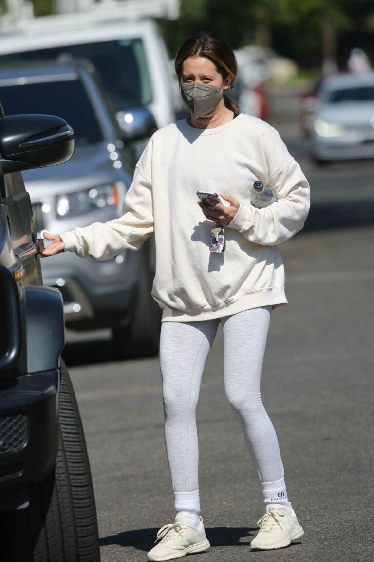 Ashley Tisdale in a Grey Leggings
