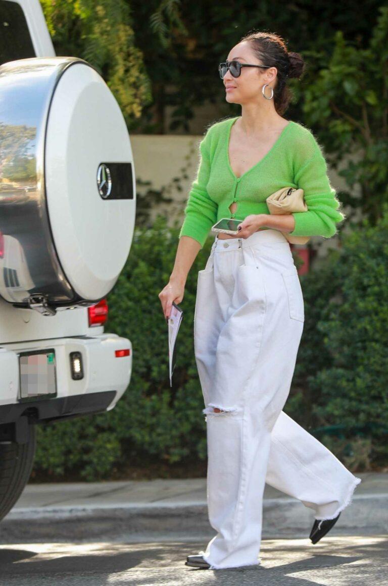 Cara Santana in a Green Blouse