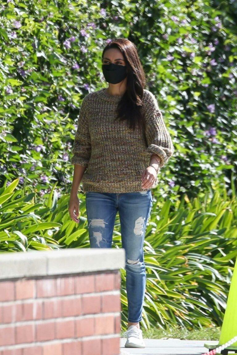 Mila Kunis in a Black Protective Mask