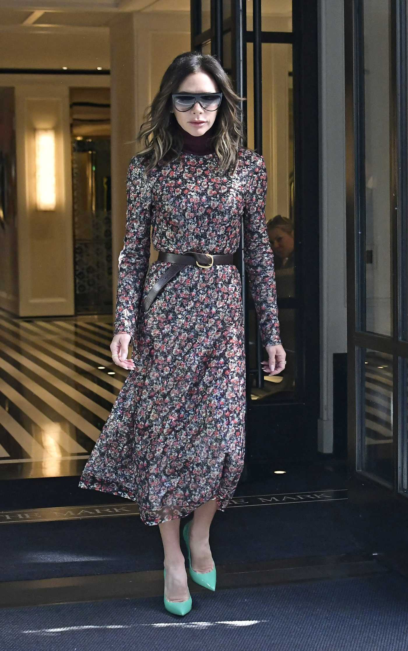 Victoria Beckham in a Floral Dress Leaves The Mark Hotel in New York 10/16/2021