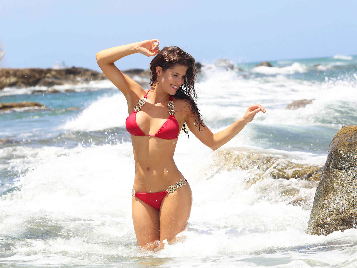 Amanda Cerny wearing a red bikini filming music video in Aruba