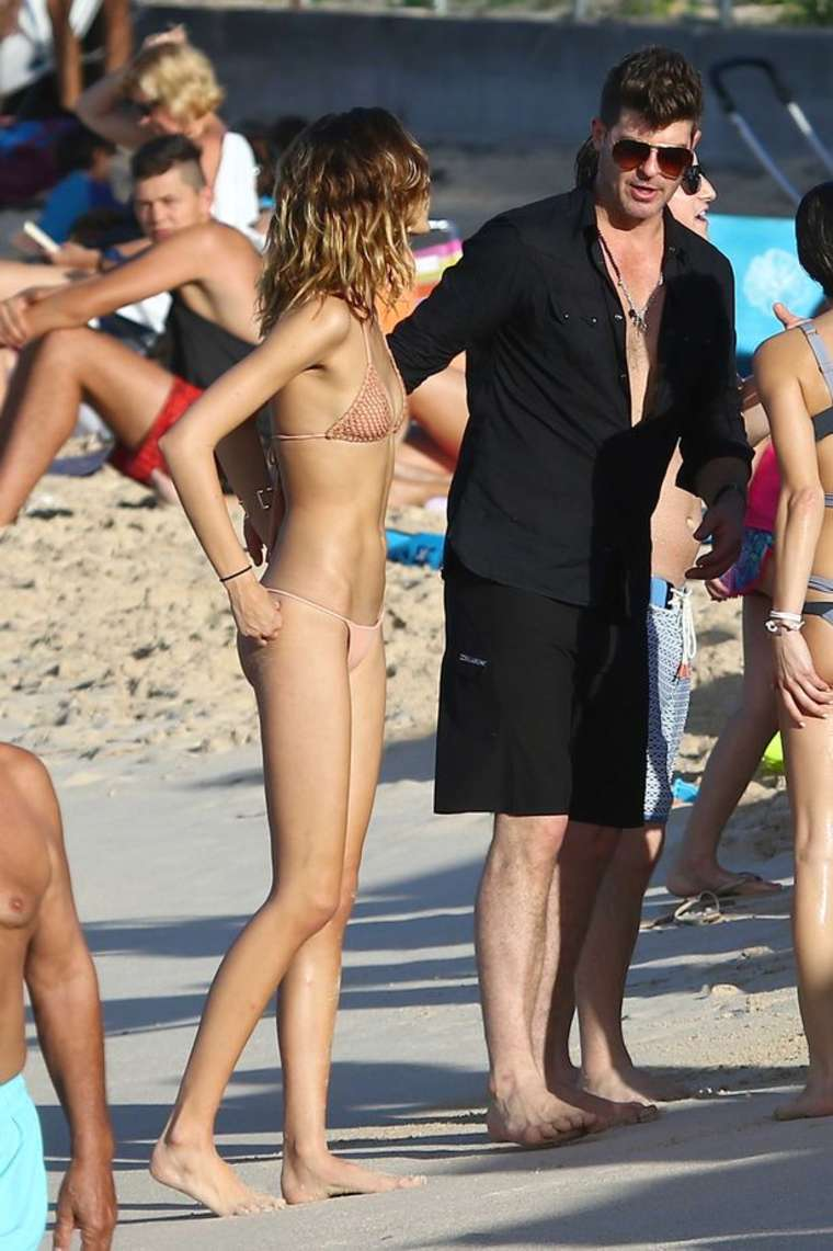 April Love Geary in Bikini on the beach in St Barts