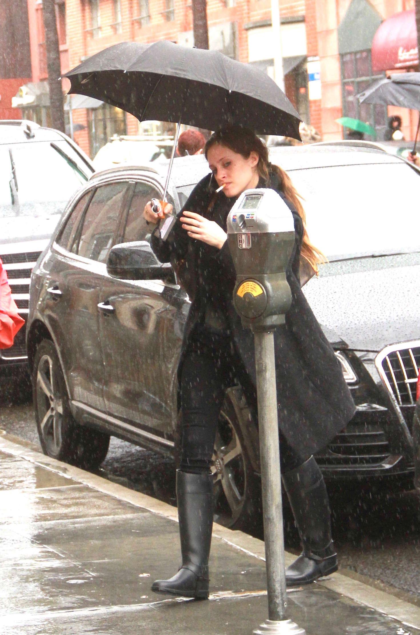 Carly Chaikin Shopping in the rain in Beverly Hills