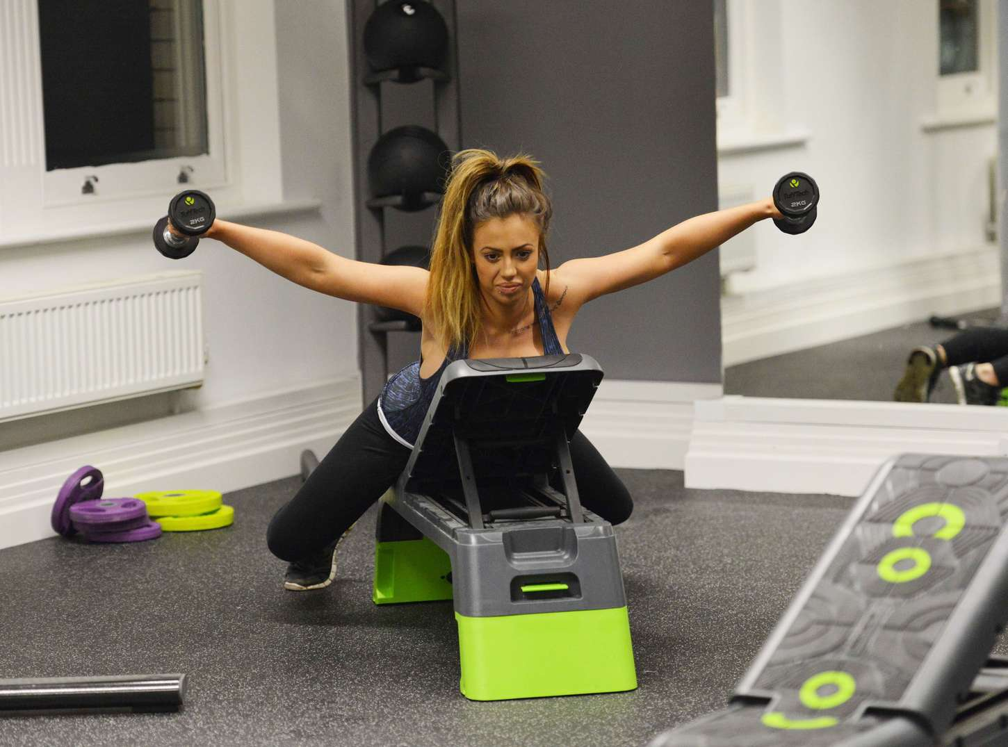 Holly Hagan Exercises in the gym