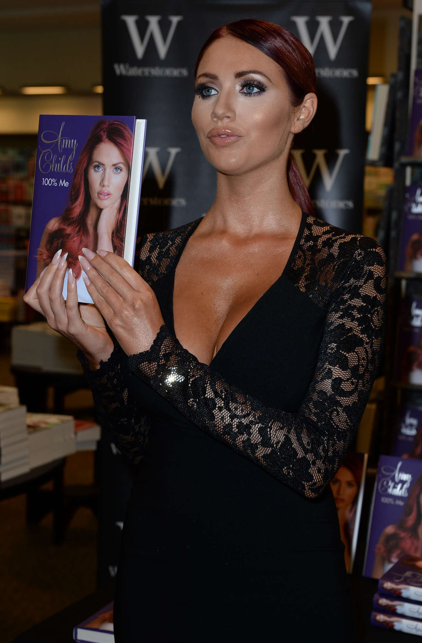 Amy Childs Signs copies of her book % Me in Manchester