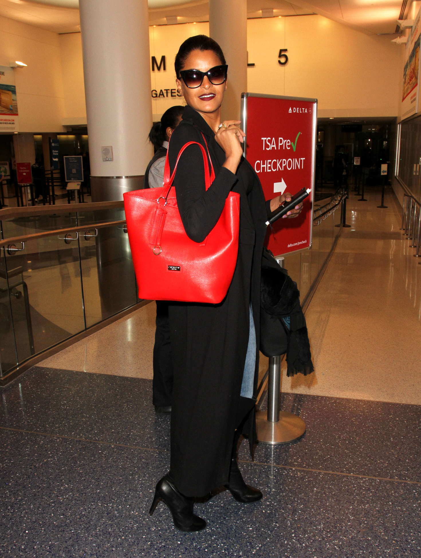 Claudia Jordan at LAX Airport in Los Angeles