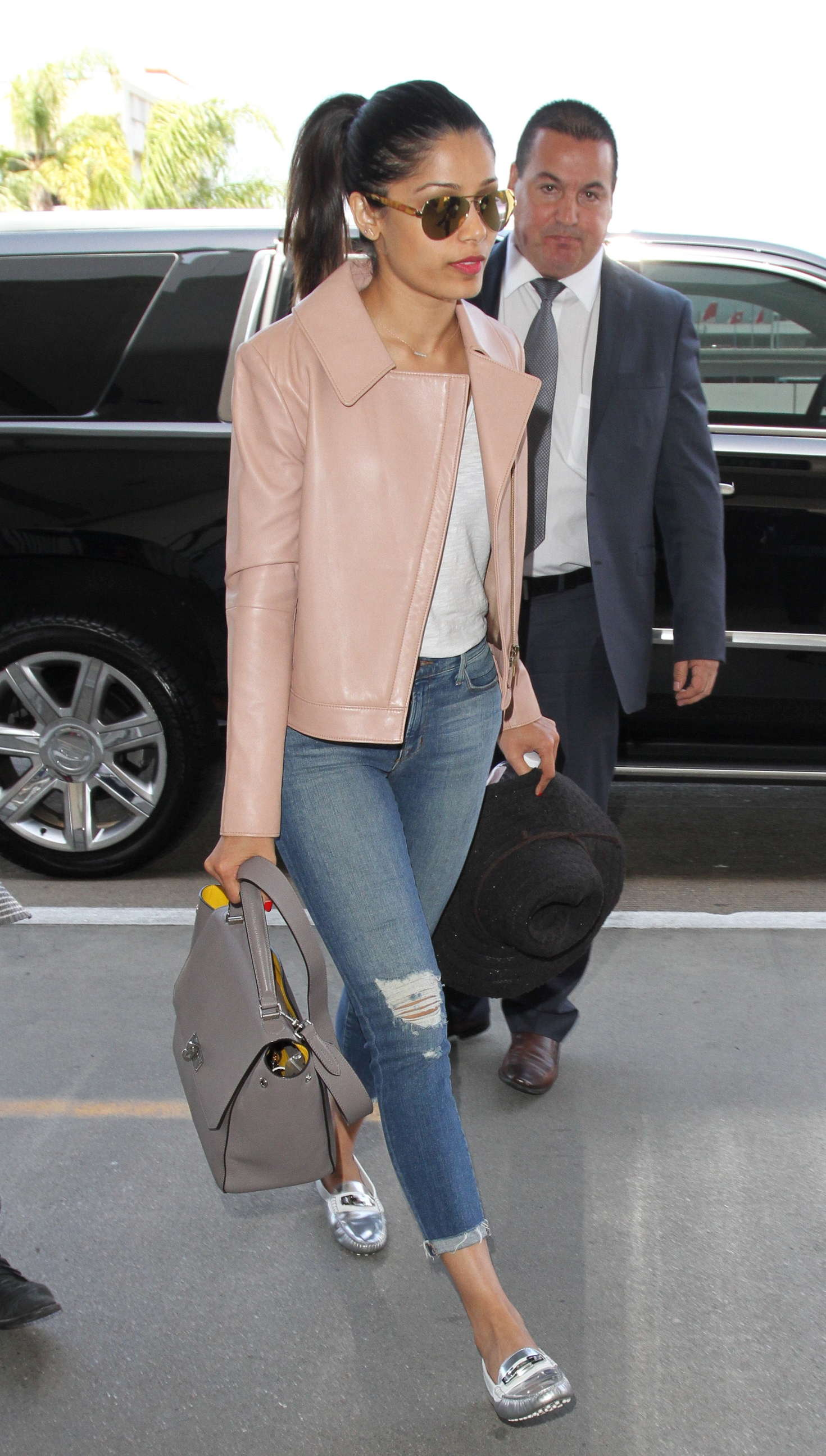 Freida Pinto in Jeans at LAX Airport in Los Angeles