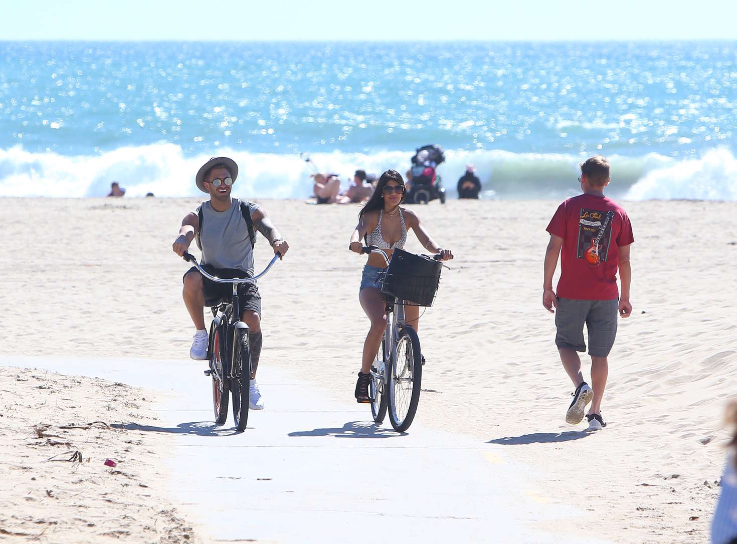 Jasmin Walia in Jeans Shorts Riding Bikes on Venice Beach