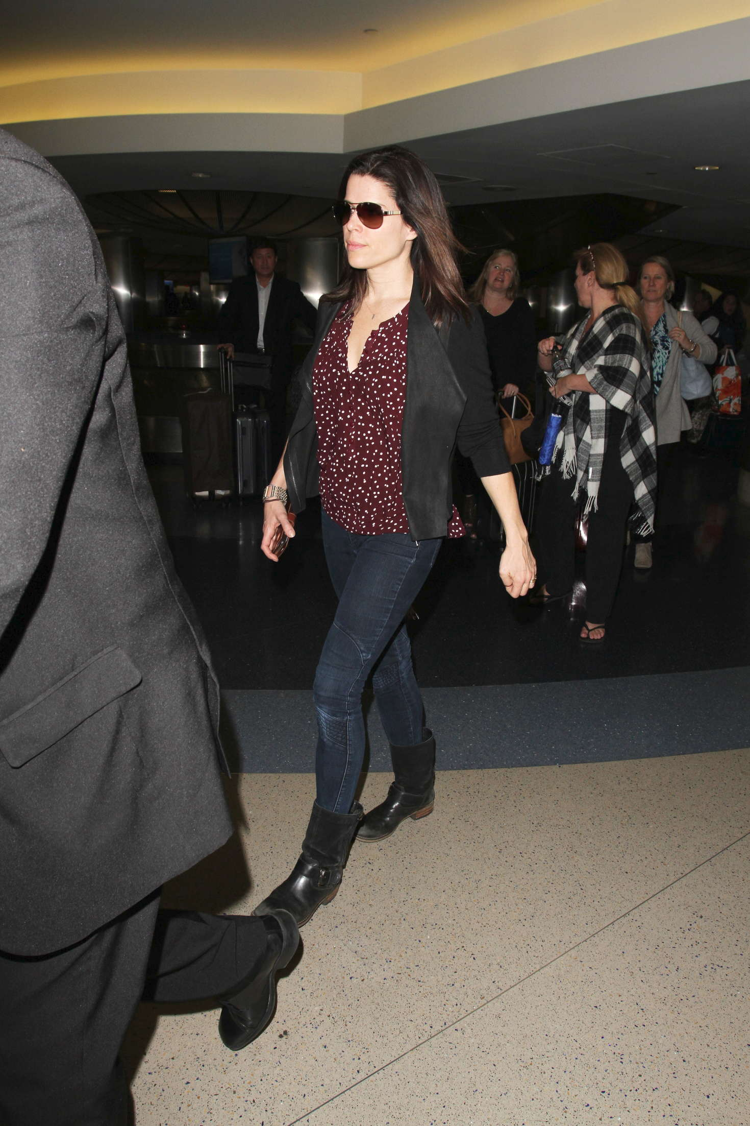 Neve Campbell Arrives at LAX Airport in Los Angeles